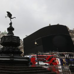 The electronic signboard at Piccadilly Circus, the iconic space in central London, was turned off Monday as part of a monthslong renovation. When the board is back online this fall, one giant screen will replace the six currently used for advertisements.