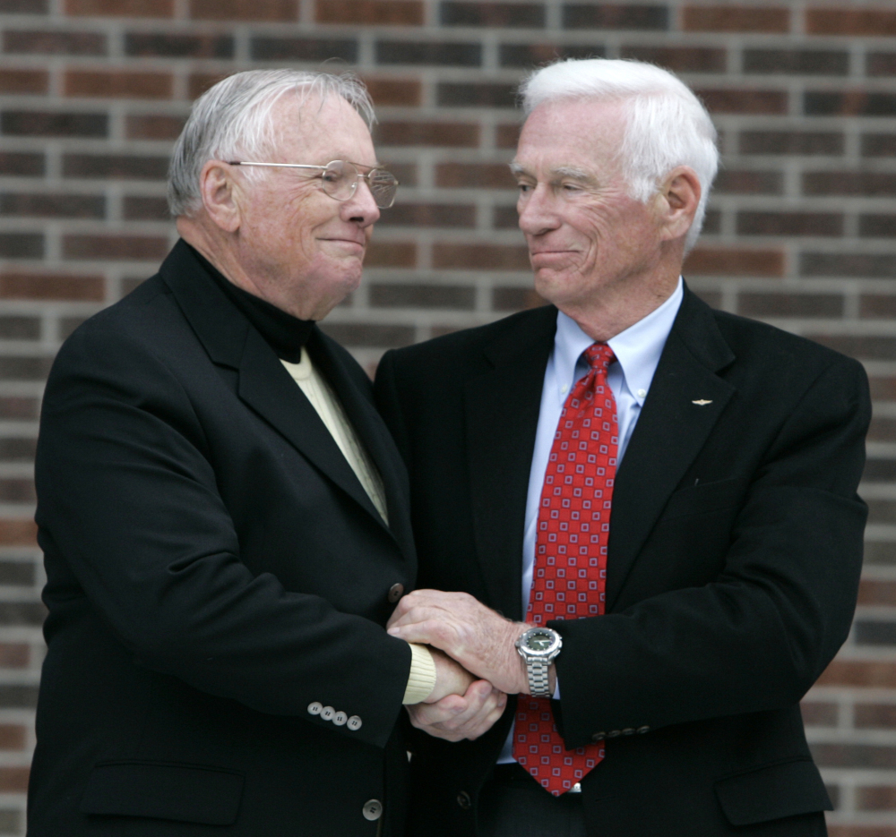 Former astronaut Gene Cernan, right, with fellow space traveler Neil Armstrong in 2007. Cernan died Monday in Texas at 82. His dream of seeing someone follow in his footsteps by walking on the moon went unfulfilled.