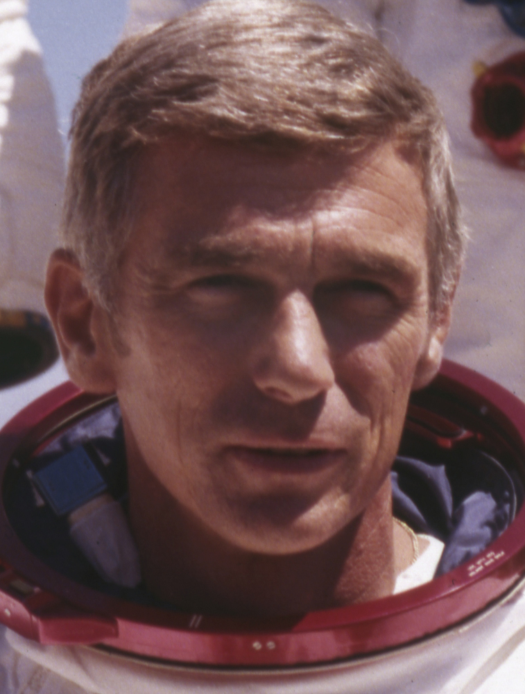 In this file photo, Eugene Cernan dons a space suit. His journey was considered a bookend of America's space-age glory, along with John Glenn's orbit around the Earth a decade earlier.