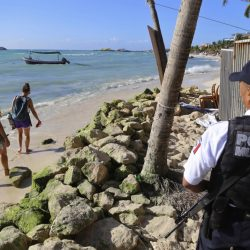 Police guard the exit of the Blue Parrot nightclub in Playa del Carmen, Mexico, on Monday. A deadly shooting occurred at the nightclub in the early morning hours Monday.