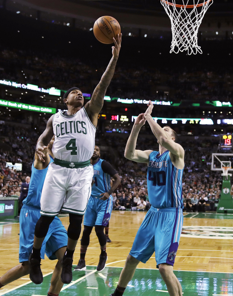Isaiah Thomas drives to the basket past Hornets center Cody Zeller in the first quarter of the Celtics' 108-98 home win.
