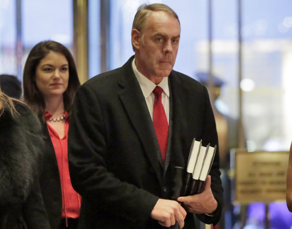 Interior Secretary-designate Rep. Ryan Zinke, right, R-Mont., says he would never sell, give away or transfer public lands, a crucial stance in his home state of Montana and the West, where access to hunting and fishing is considered sacrosanct.