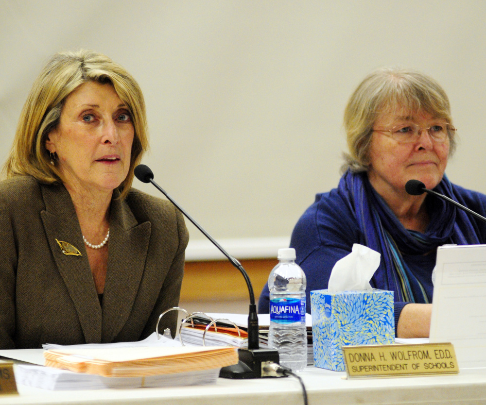 Superintendent Donna Wolfrom, left, speaks Wednesday beside board Chairwoman Terri Watson during an RSU 38 board meeting where parents and teachers expressed concern about mold at Manchester Elementary School.