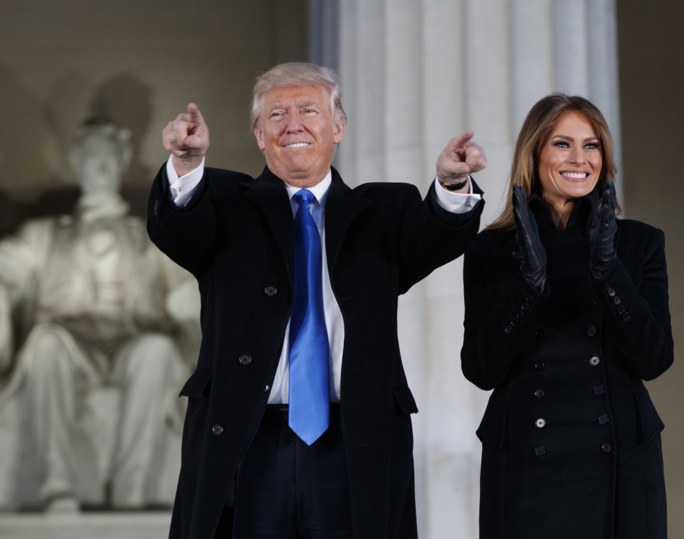 President-elect Donald Trump, left, and his wife Melania Trump arrive to the pre-inauguration concert at the Lincoln Memorial on Thursday night in Washington.