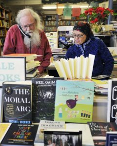 Lawless and his wife Beth Leonard work behind the counter together at their book store.