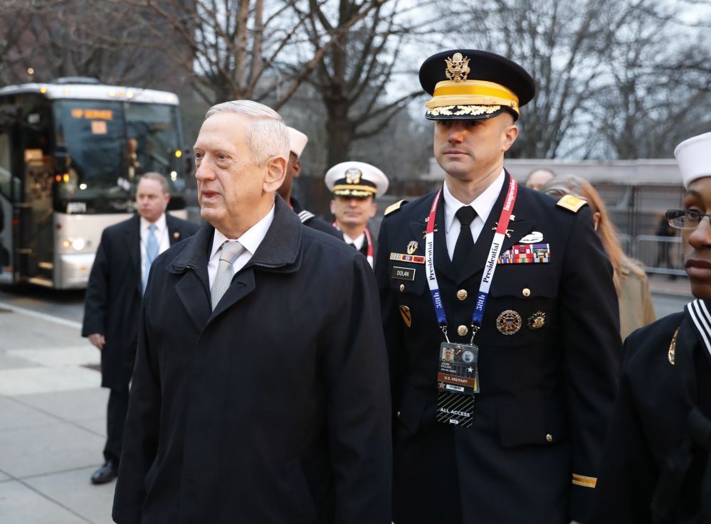 Retired Gen. James Mattis arrives for church service at St. John's Episcopal Church in Washington on Friday. Later in the day, the Senate confirmed Mattis' appointment as defense secretary.