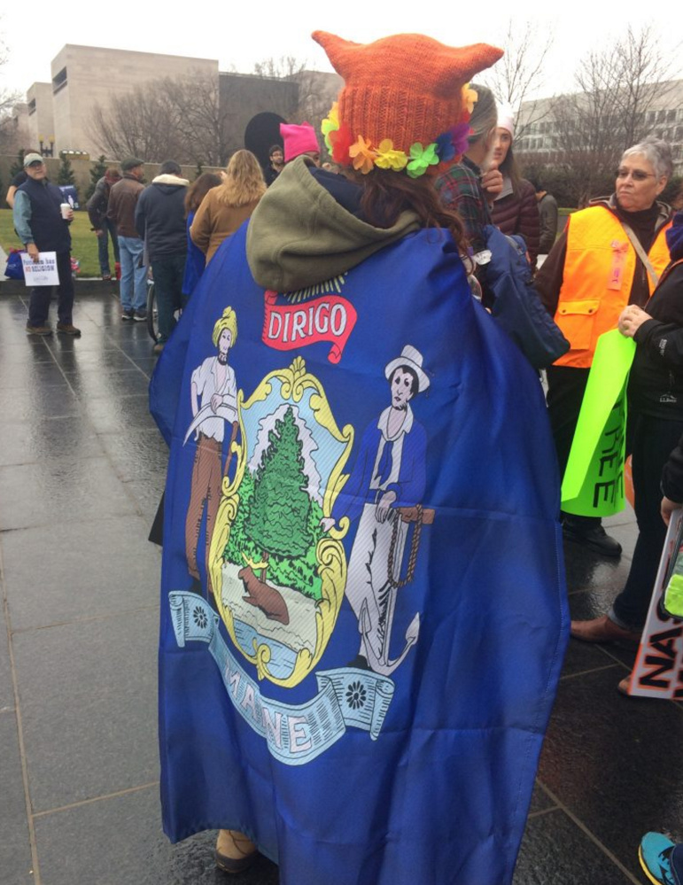 A marcher wears a Maine state flag near the National Mall before the Women's March on Washington.
