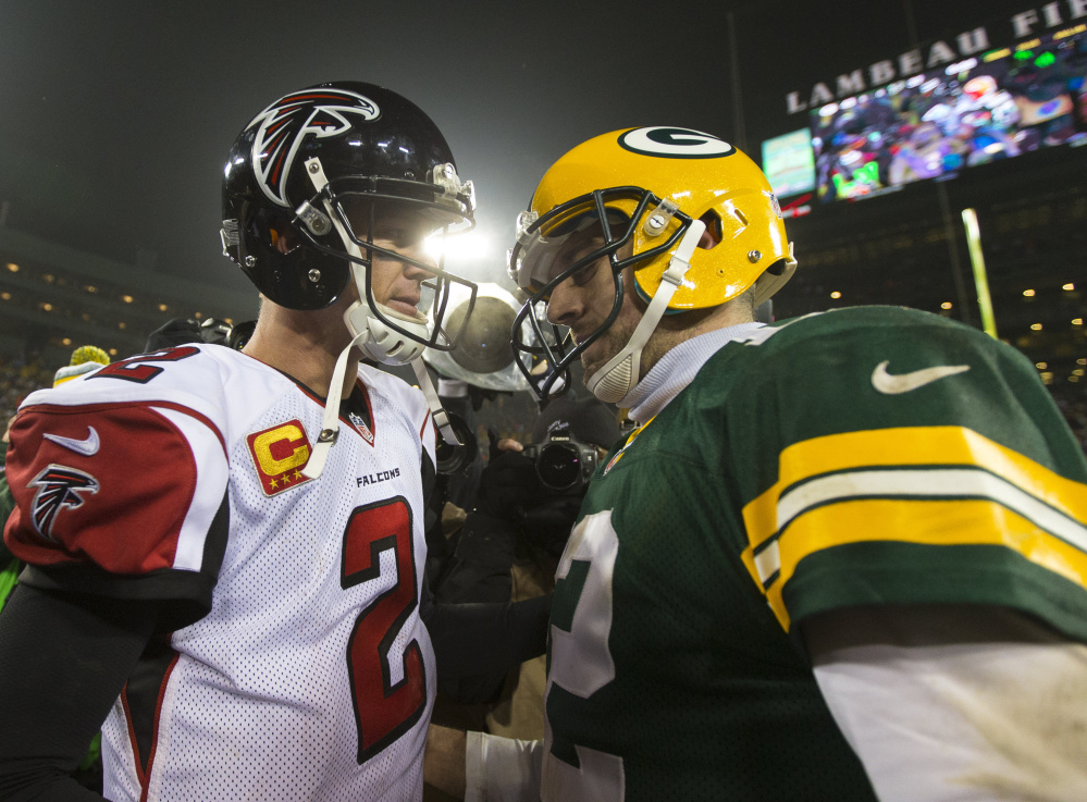 Atlanta quarterback Matt Ryan, left, and Green Bay quarterback Aaron Rodgers are expected to put on a offensive show when they play for the NFC championship Sunday in Atlanta.
