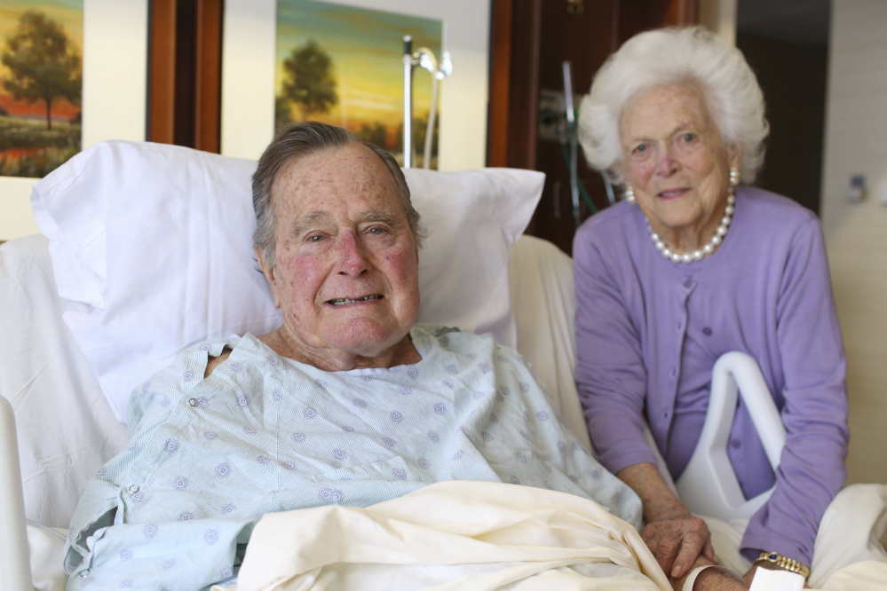 Former President George H.W. Bush and his wife Barbara pose for a photo at Houston Methodist Hospital in Houston in a photo provided Monday.