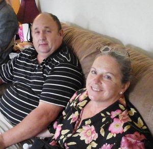 Steven and Elizabeth Rhodes are shown in a family photo. She is recovering from smoke inhalation and burns at Maine Medical Center. The fire's cause has not been determined.