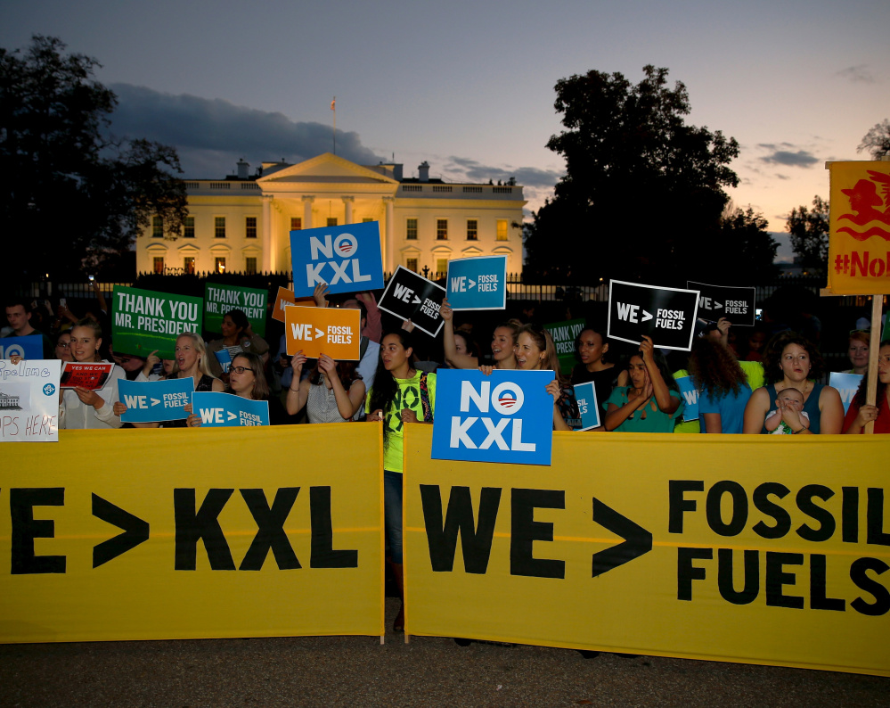 Activists celebrate the Obama administration's rejection of the Keystone XL pipeline in 2015. President Trump seeks to reverse this.