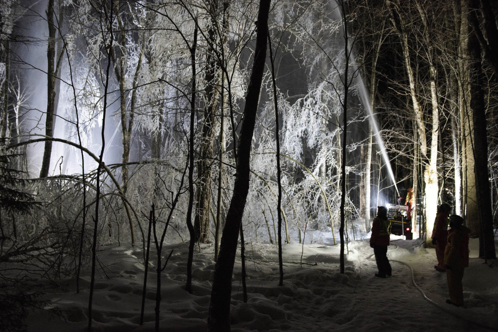A firefighting hose mounted on an ATV sprays water on trees in the Hubbard Brook Experimental Forest in Woodstock, New Hampshire.