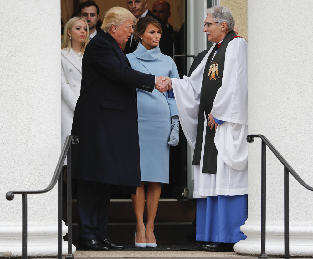 President-elect Donald Trump, accompanied by his wife Melania, shake hands with Rev. Luis Leon after attending church service at St. John's Episcopal Church across from the White House in Washington, Friday, Jan. 20, 2017. (AP Photo/Pablo Martinez Monsivais)