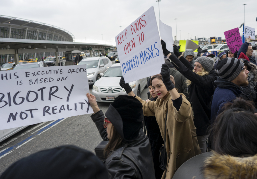 Protesters assemble at John F. Kennedy International Airport in New York, Saturday, Jan. 28, 2017 after two Iraqi refugees were detained while trying to enter the country. On Friday, Jan. 27, President Donald Trump signed an executive order suspending all immigration from several majority-Muslim countries for 90 days.