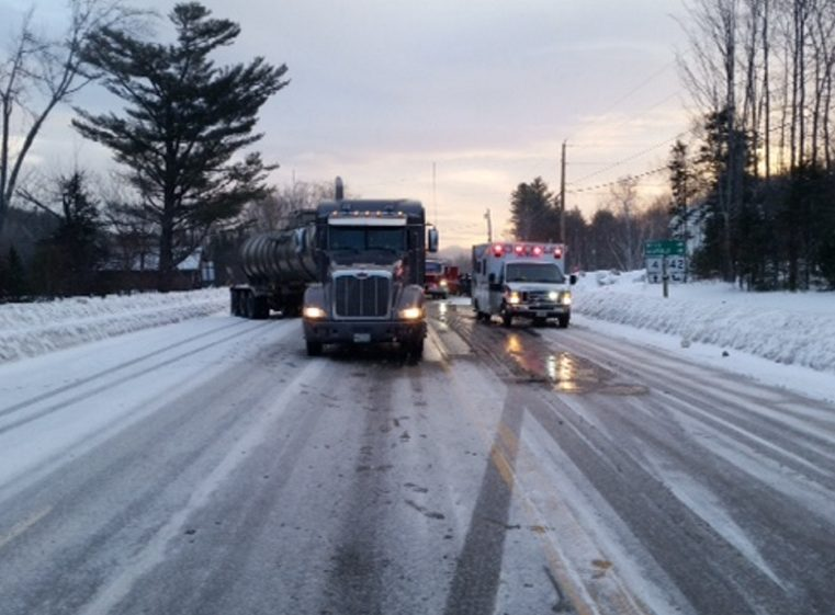 A tractor-trailer stands askew Saturday morning at the side of Rangeley Road in Phillips after it collided with a 1997 Ford Ranger pickup truck. A Dixfield man died later of injuries he suffered in the crash.
