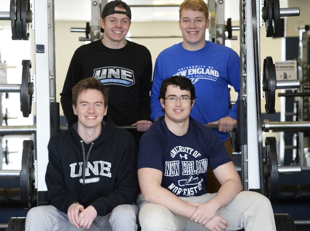 University of New England students Henry Shroder and Eric Ruest (front) and Christian Dunbar and Ryan Phelps (back) are preparing for the debut of their school's football program, which will play a sub-varsity schedule in 2017 and move to varsity status in 2018.