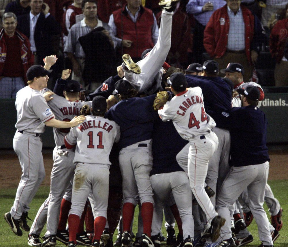 The Boston Red Sox celebrate after beating the St. Louis Cardinals 3-0 in Game 4 to sweep the 2004 World Series against St. Louis. The championship – the first for the Red Sox in 86 years – is at the top of Tom Caron's list.