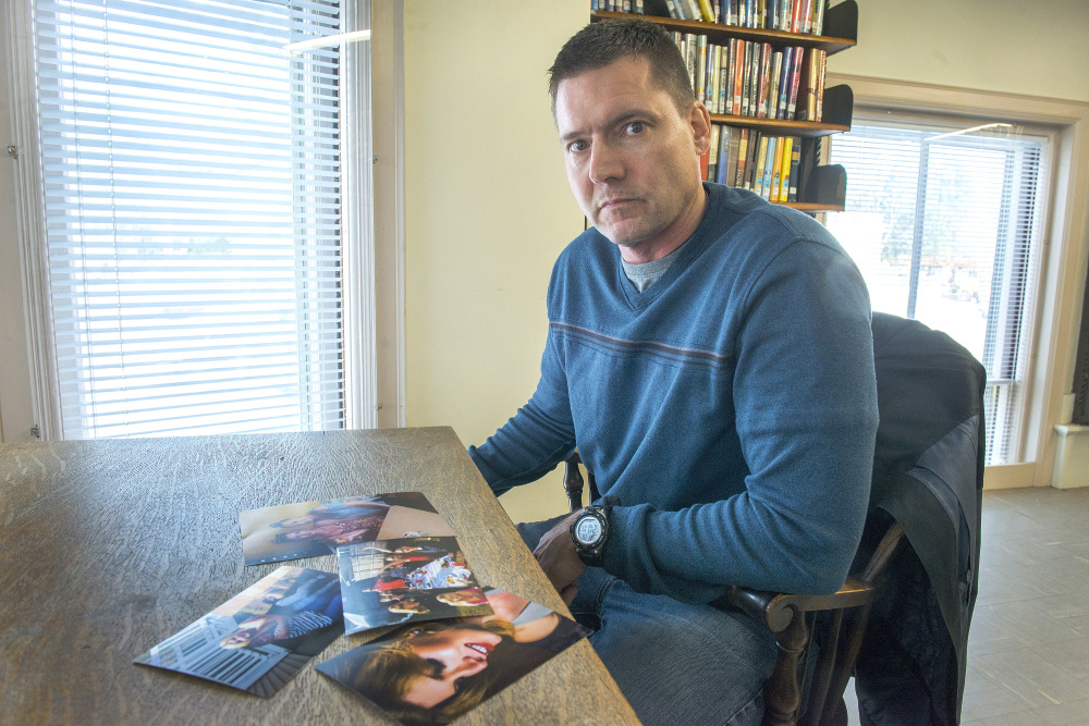 Amber Morrow's father, Andrew Morrow, with photographs of his daughter and other family members. Morrow's mother, Jen Morrow, said that she knew her daughter was transgender when she was only a child.