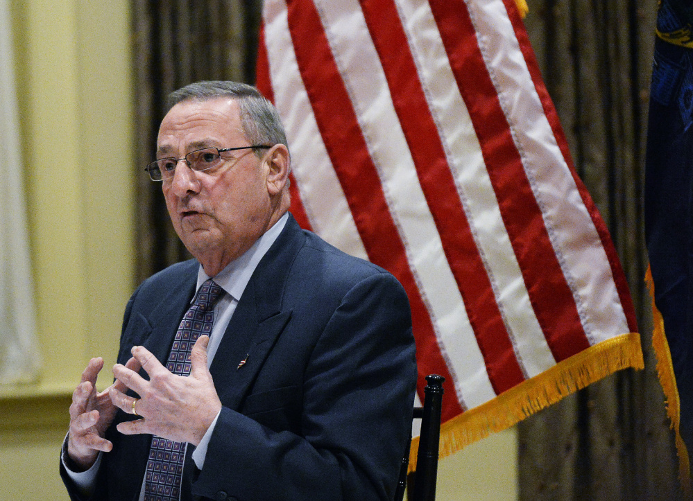 Gov. Paul LePage speaks to an audience of about 200 people at his town hall meeting Tuesday night in York. He said he doesn't oppose raising Maine's minimum wage, but the increases prescribed in the ballot initiative that voters passed in November will drive up prices and ultimately hurt Maine's elderly.