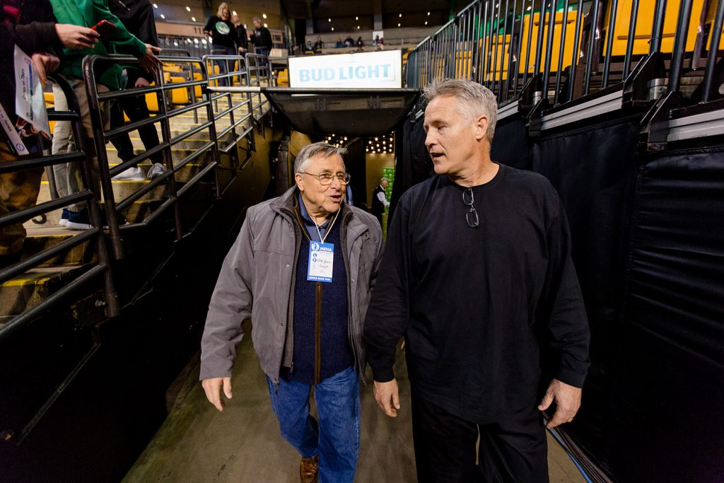 Bob Brown, left, of Scarborough walks out of the tunnel at TD Garden in Boston with his son Brett, coach of the Philadelphia 76ers.