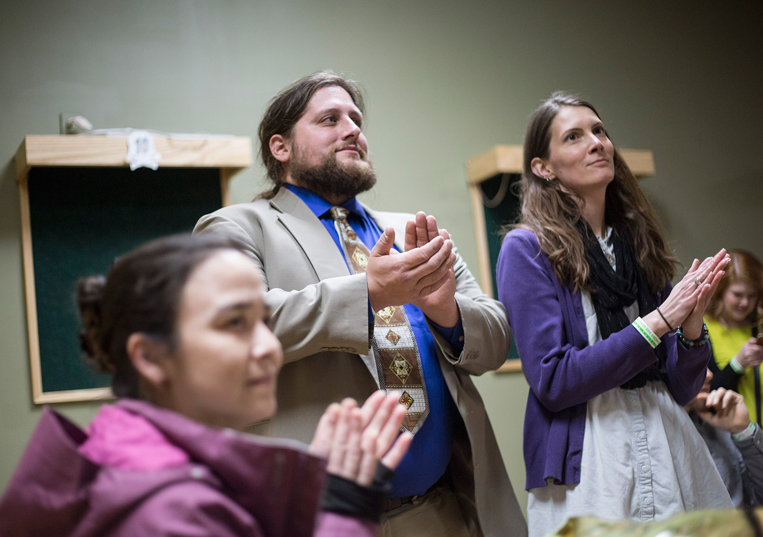 "Sherri Bukovskey of Gray, left, Paul McCarrier of Knox and his girlfriend, Carole Quigley of Monroe, applaud a speaker at Monday night's ""End of Cannabis Prohibition Party"" at The Gold Room in Portland. Police told the event's organizers Monday afternoon that trading and consuming marijuana at the event would be a violation of the law because The Gold Room is a public space."