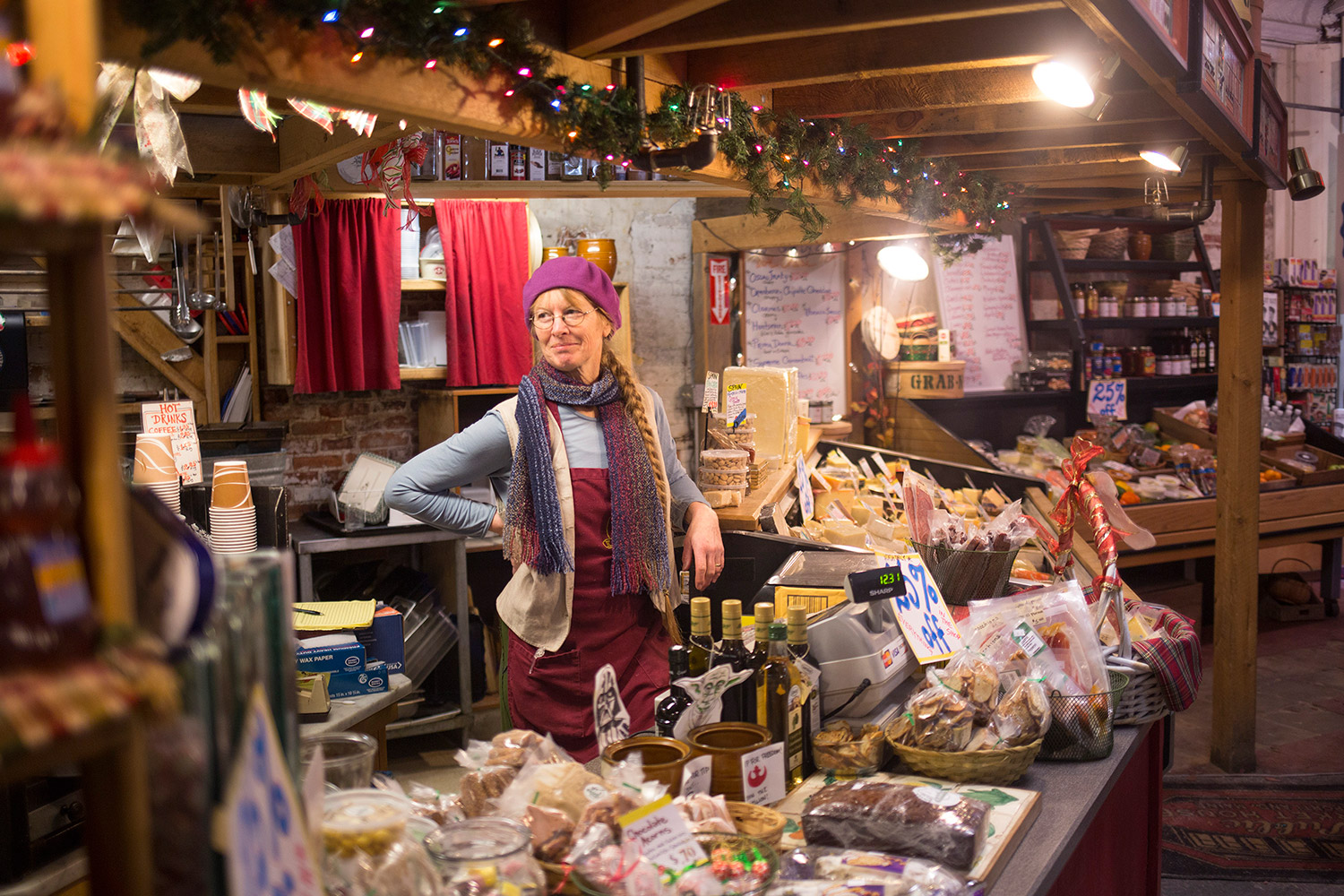 Kris Horton, owner of K. Horton Specialty Foods, works Tuesday evening at her shop in the Public Market House on Monument Square. Horton will close the shop, after 18 years in business.
