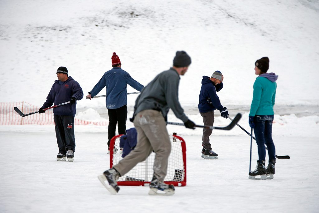 Pickup hockey games at Riverside Municipal Golf Course in Portland are informal, with players taking turns and switching sides.
