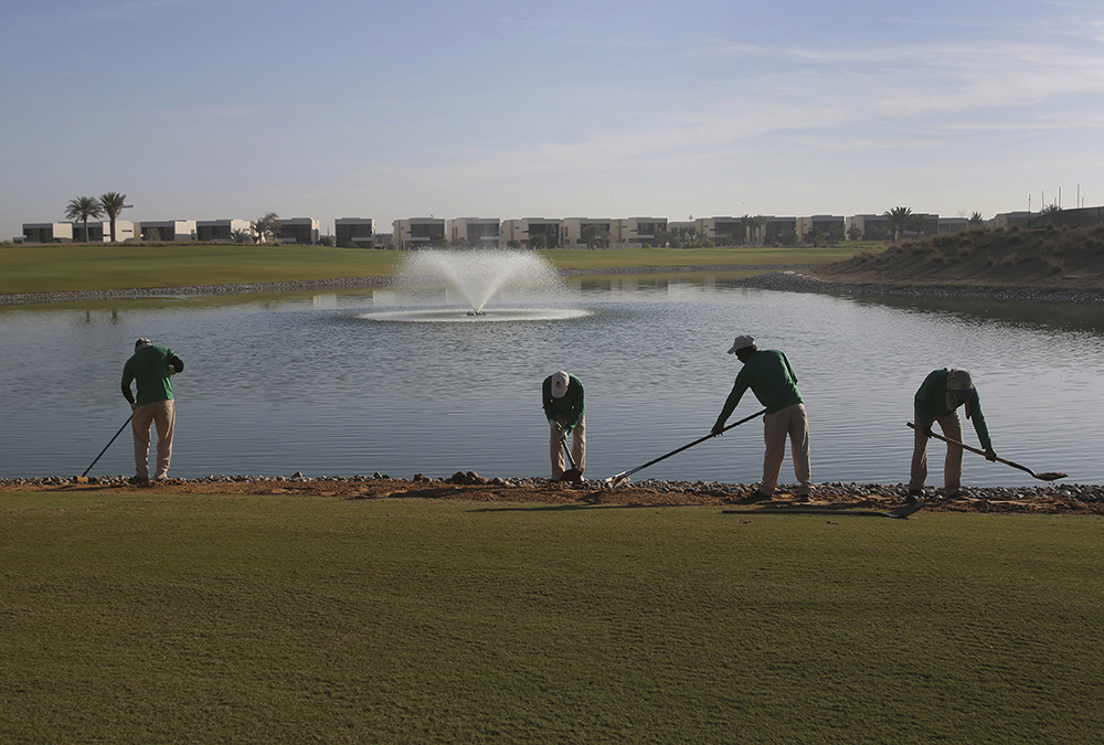Gardeners put final touches on greens at the Trump International Golf Club, which is located inside Akoya, a massive housing development of 2,600 villas and 7,000 apartments developed by Dubai-based luxury real estate DAMAC Properties. Another Trump-managed golf course is planned for another, even larger, DAMAC project under development down the road.