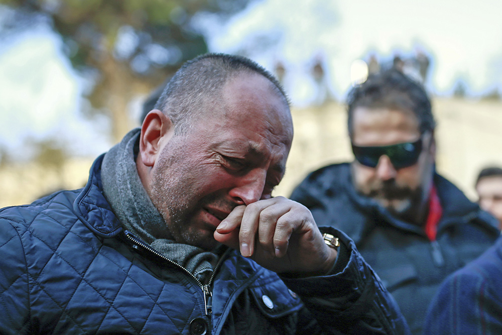 People grieve during a march to memorialize the victims of the New Year's Day nightclub attack, in Istanbul, Tuesday. Associated Press/Emrah Gurel