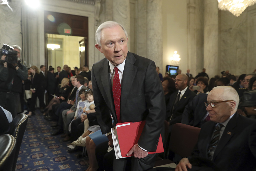 Attorney General-designate Sen. Jeff Sessions, R-Ala., takes his seat Tuesday before his confirmation hearing before the Senate Judiciary Committee. Former Attorney General Michael Mukasey is at right. <em>Associated Press/Andrew Harnik</em>
