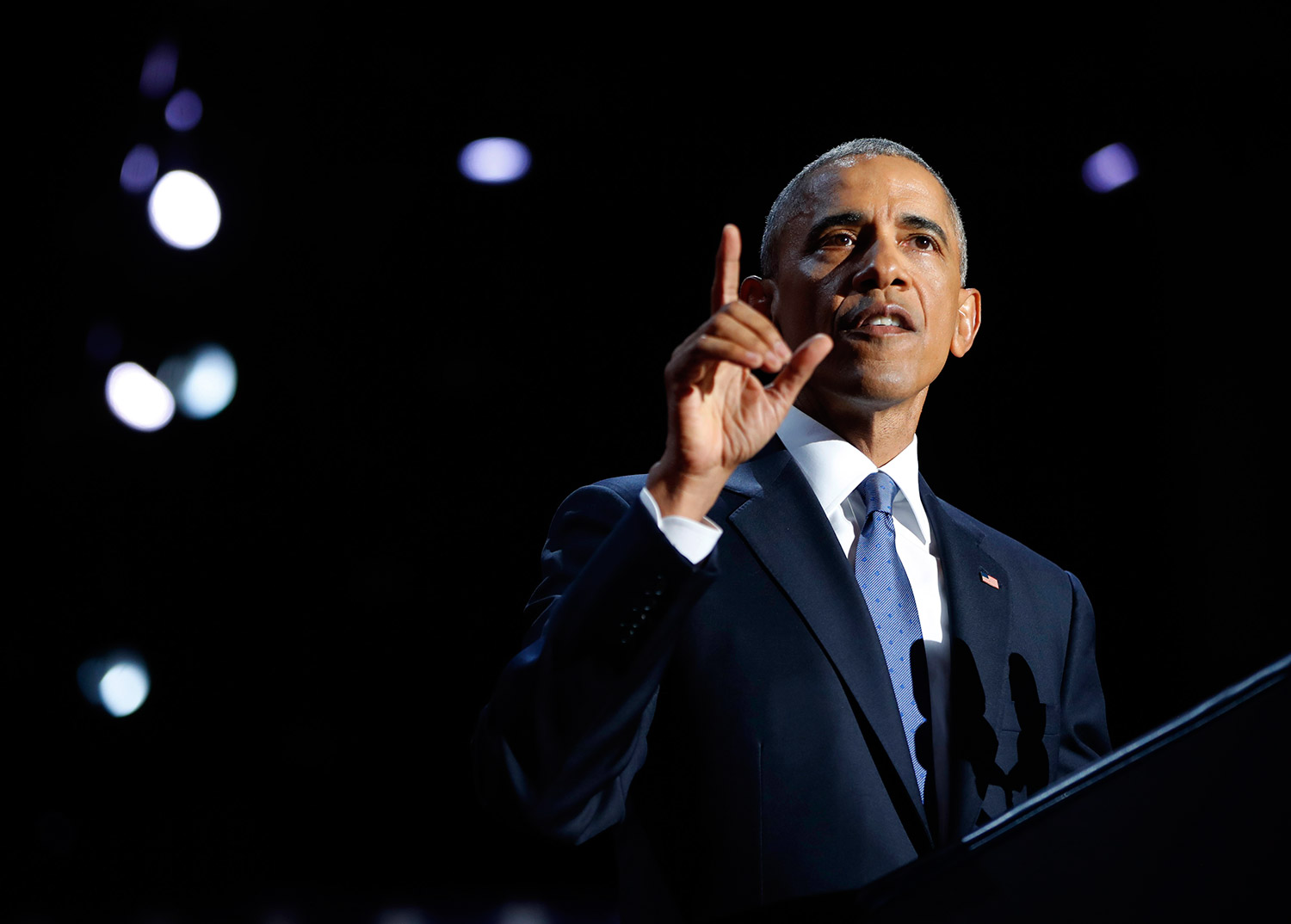 "President Obama speaks during his farewell address at McCormick Place in Chicago on Tuesday night. He said he ends his tenure inspired by America's ""boundless capacity"" for reinvention. Associated Press/Pablo Martinez Monsivais"