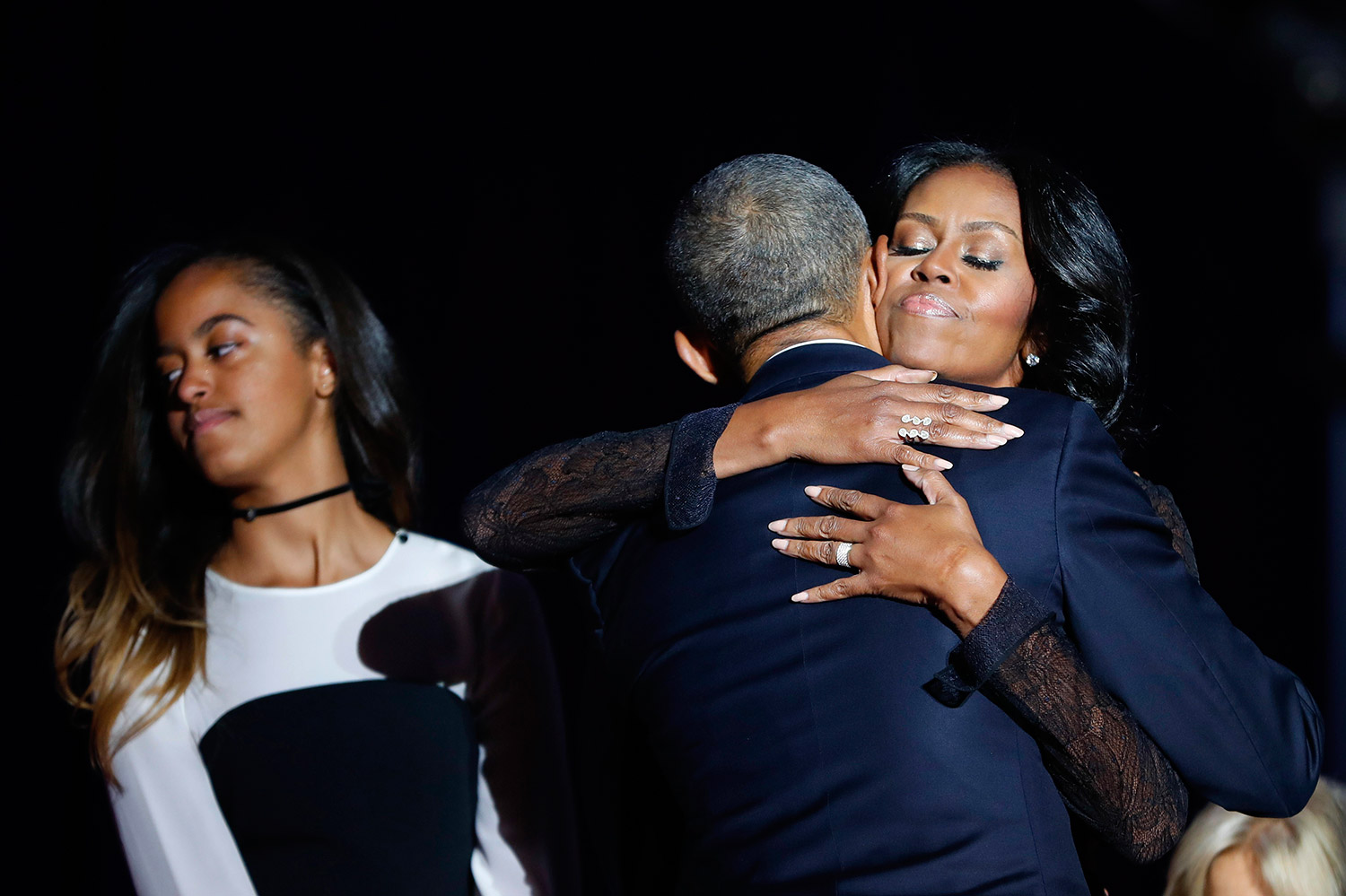 The Obamas hug after his farewell address, next to their daughter Malia. Associated Press/Pablo Martinez Monsivais