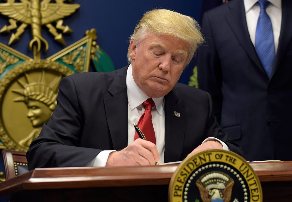 "President Trump signs an executive order Friday for ""extreme vetting"" of potential refugees from predominantly Muslim nations."