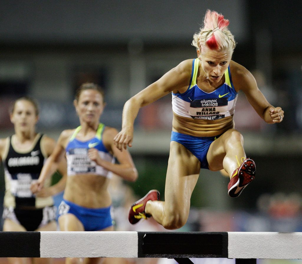 Anna Willard goes over the last barrier to win the women's 3,000-meter steeplechase final at the U.S. Olympic Track and Field Trials in Eugene, Ore., in 2008. Willard set an American record with a time of 9:27.59.