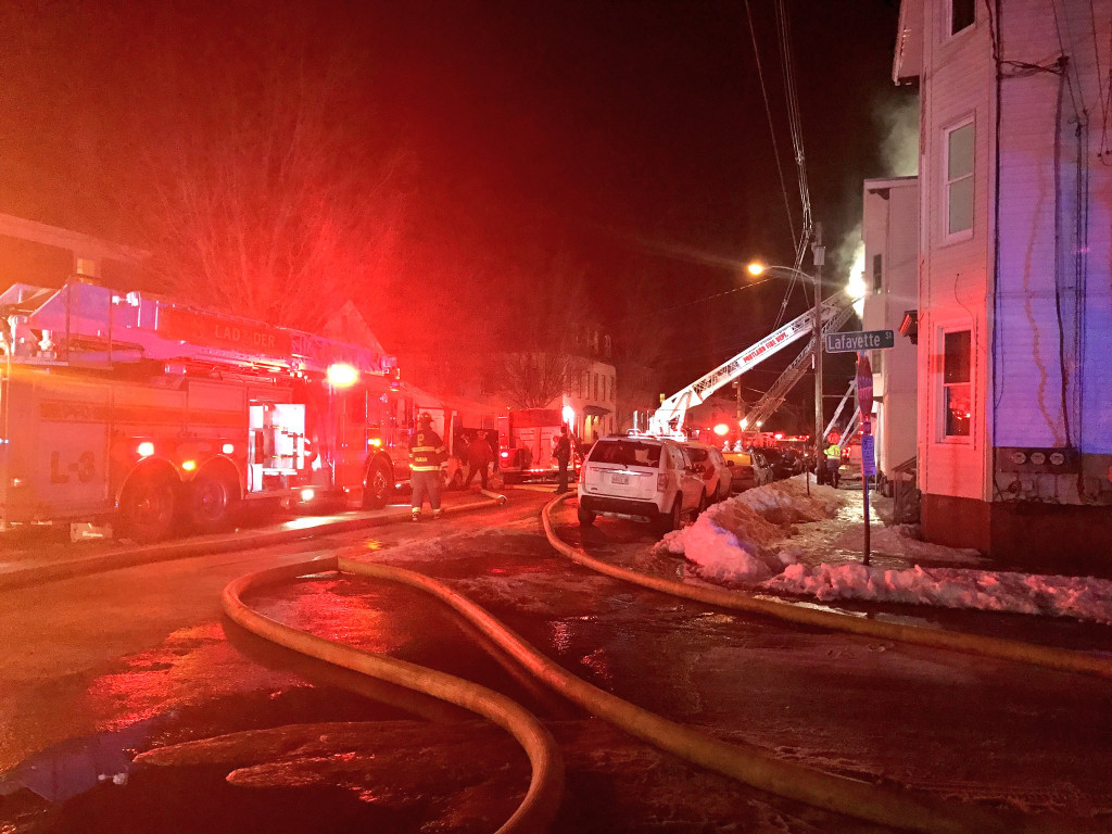 Fire crews respond to a fire on Cumberland Avenue in Portland Monday night.