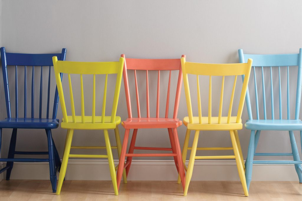 Wooden chairs can be re-invented by spray-painting in vivid shades.