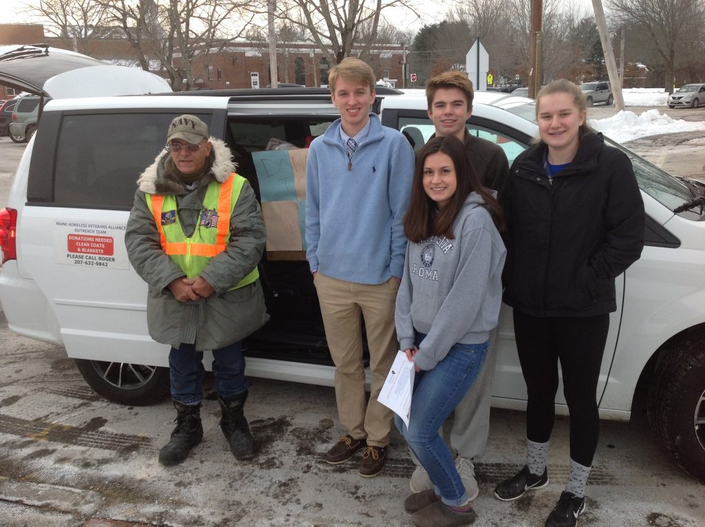 At Greely High School in Cumberland on Tuesday, students and Roger Goodoak of the Maine Homeless Veterans Alliance take a break from loading the MHVA van with clothing, backpacks and toiletries to be distributed to the homeless. The students collected the goods after voting to support the MHVA for their Community Service Club project. From left are Goodoak, A.J. Eisenhart, Quinn Molloy and Rachel Ferris. In front is Hannah Doolittle.