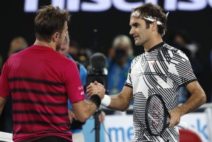 Switzerland's Roger Federer, right, is congratulated by compatriot Stan Wawrinka, after winning their semifinal at the Australian Open.