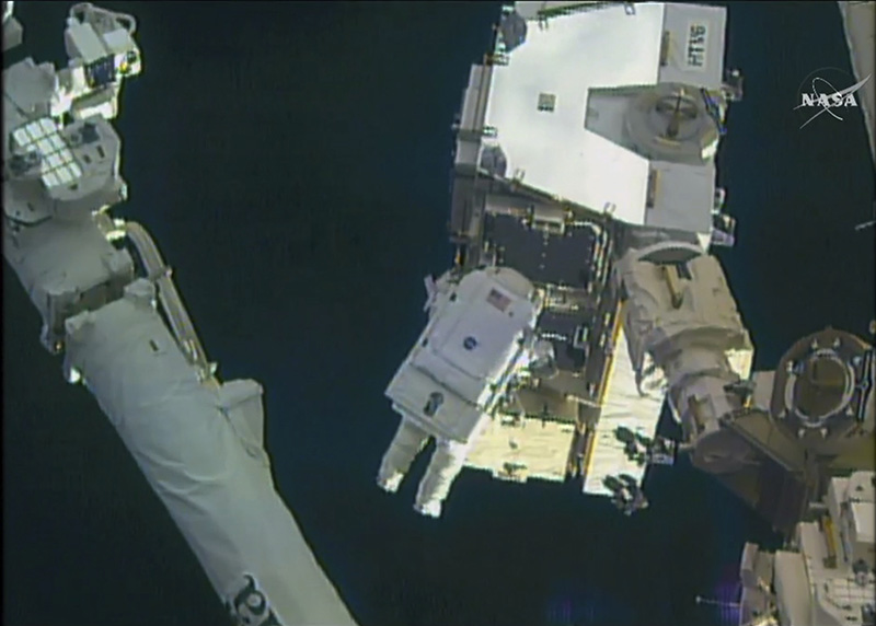 Astronaut Peggy Whitson takes a spacewalk outside the International Space Station on Friday.