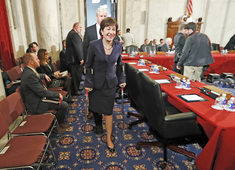 Sen. Susan Collins, R-Maine arrives on crutches at a Senate Judiciary Committee hearing for Attorney General-designate Sen. Jeff Sessions, R-Ala., last Tuesday.