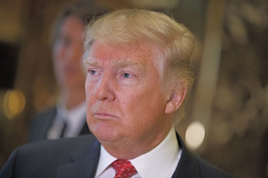 President-elect Donald Trump listens to a reporter's question at Trump Tower on Monday in New York. It has been six months since Trump gave a formal news conference, during which he made headlines by inviting Russian hackers to release Democratic opponent Hillary Clinton's private emails.<em>Associated Press/Evan Vucci</em>