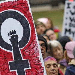 Participants holds signs as they gather near the Ohio Statehouse steps during the Womens March on Washington - Ohio Sister March on Washington in Columbus, Ohio on Sunday, Jan. 15, 2017. (Brooke LaValley/The Columbus Dispatch via AP)
