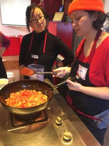 Cara Stadler, right, of Tao Yuan and Bao Bao Dumpling House, takes a shanxi noodle-making class in Beijing.