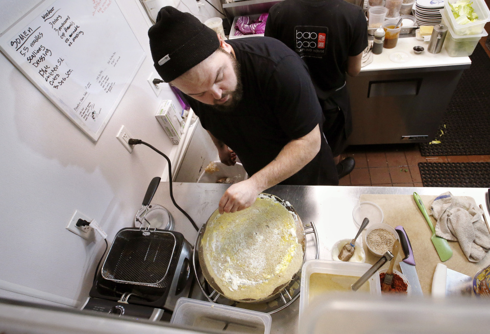 Chef Josh Amergian of Bao Bao Dumpling House prepares jianbing – a popular street food with a crepe-like outer wrap. Amergian recently returned from China, where he developed an affinity for the dish.