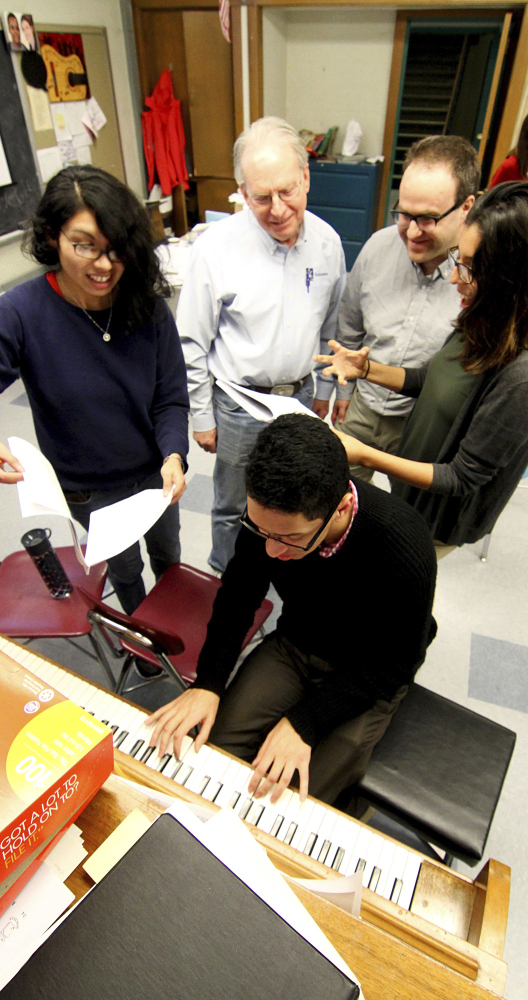 UMass Lowell student Mirza Garcia, from left, professors Jesse Heines and Dan Walzer and students Nicole Vasconcelos and Christian Hernadez at piano.