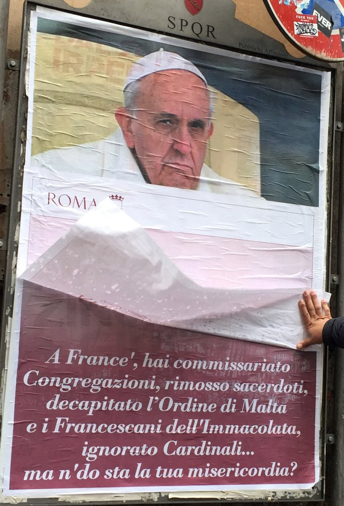 On Saturday, posters appeared around Rome featuring a stern-looking Francis and questioning,