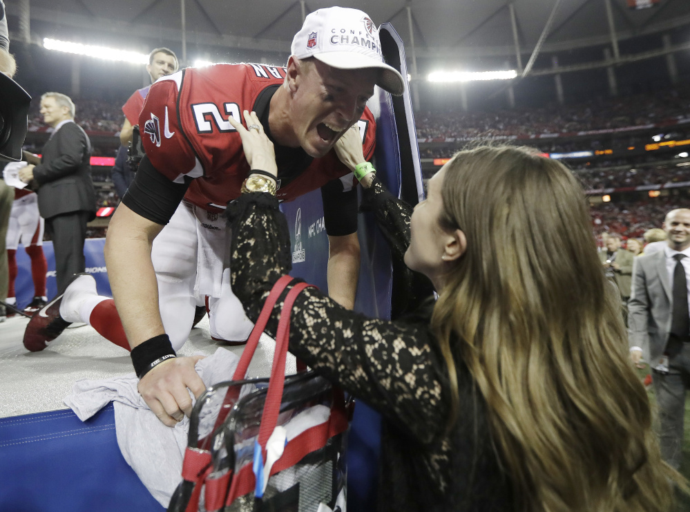 Falcons quarterback Matt Ryan embraces his wife, Sarah – a Falmouth native – after Atlanta's victory over Green Bay in the NFC championship game on Jan. 22.
