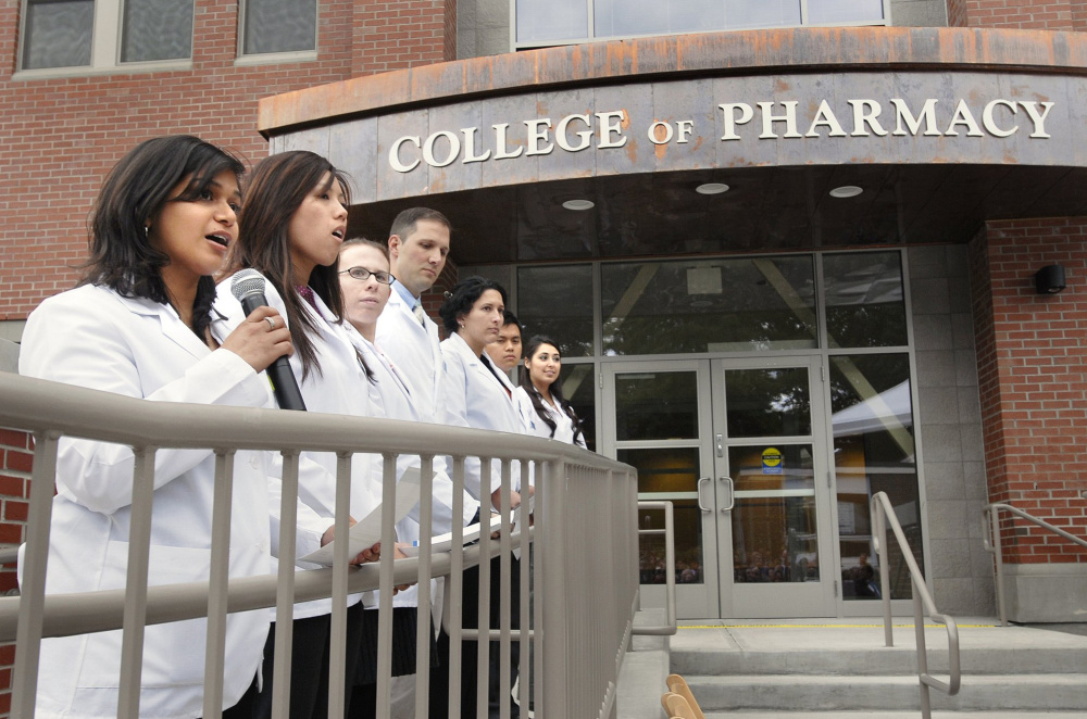 "Members of UNE's first pharmacy class attend a dedication ceremony at the Portland campus in 2009. From the Fitch report: ""UNE has grown total (full-time equivalent) enrollment by over 30 percent in the past five years, largely by adding or expanding its graduate and professional programs in the health and social sciences fields."""