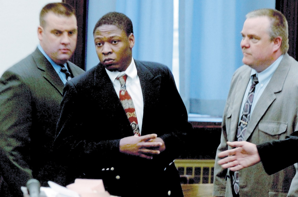 Daniel L. Fortune, center, at the Somerset County Superior Court in Skowhegan in 2010. He is looking to appeal a unanimous ruling that affirmed his life sentences in an attack that nearly killed a girl and her father