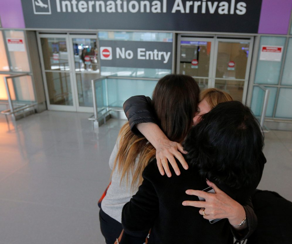 Mahnaz Kanani Zadeh, center, is greeted by her niece Negin, left, and sister Azar after arriving at Logan Airport in Boston from Iran on Monday.